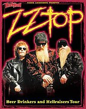 "A black poster with loud colors occupying most of it. The image shows ZZ Top facing forward as Billy Gibbons has his hands resting on the headstock of a guitar. The text on the poster reads ""ZZ Top Beer Drinkers and Hellraisers Tour""."