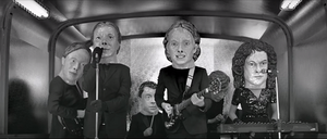 "Reflektor (song) - A still from the regular ""Reflektor"" music video, displaying each band member wearing an oversized papier-mâché head."