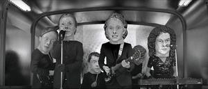 "Reflektor (song) - A still from the regular ""Reflektor"" music video, displaying each band member wearing an oversized papier-mâché head."