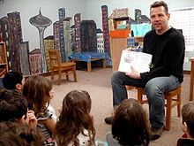Roff reads one of his books to a classroom at a West Seattle school, March 2008