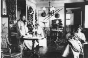 Col. Frederick Funston and Mrs Eda Funston in their family living room in the Presidio of San Francisco.