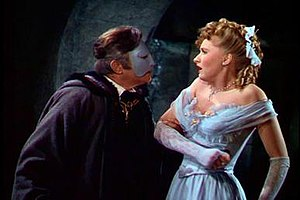 Phantom of the Opera (1943 film) - Claude Rains as Erique Claudin, the Phantom, with Susanna Foster as Christine DuBois in Universal's 1943 version of Phantom of the Opera.