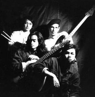 The Dawn (band) - The Dawn ca. late 80's (L-R, front to rear) the late Teddy Diaz (guitar), Jett Pangan (vocals), JB Leonor (drums) and Carlos Balcells (bass guitar)