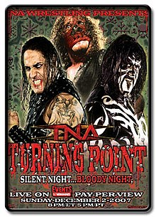 A poster depicting three men wearing black wrestling gear; one wearing black and white face paint, another wears a red mask, and the final spews blood from his mouth.