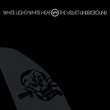 The album cover; a faint image of a tattoo of a skull. It is difficult to distinguish the tattoo, as the image is black, printed on a slightly lighter black background. On this cover, the album name, Verve logo, and band name are all on one line.