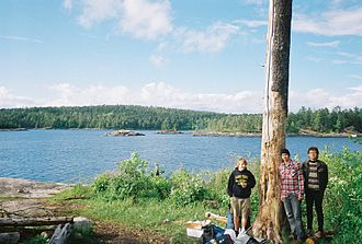 Boundary Waters Canoe Area Wilderness Act - A group of young canoeists at a campsite on Iron Lake in the BWCA.
