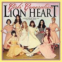 The album cover is surrounded by orange and yellow borders, with the group's name and the album title cover appearing above them colored in orange and black, respectively. The band members are clothed in 1950s style dresses.