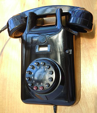 Push-button telephone - Heemaf 1955 type wall telephone by Philips with DC signaling pushbutton dial (Netherlands, Dec.1962).