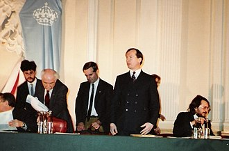International Monarchist League - European Monarchist Congress, Warsaw, 8–9 Dec 1990. Gregory Lauder-Frost standing centre, Paul Benoit, Vice-President of the ML of Canada is to his right and Ivan Marczewski of the Bulgarian Monarchist-Conservative Union sits on his left.