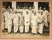 Tamil Brahmins (Iyers and Iyengars) in traditional veshti and angavastram at a convention of the Mylai Tamil Sangam, circa early 1900s