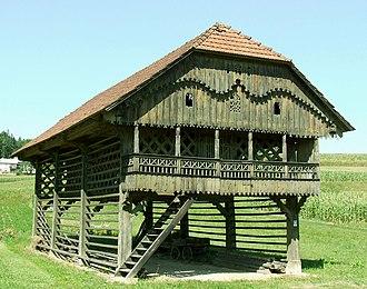 Simončič Hayrack - Simončič Hayrack is a double hayrack (toplar) with three pairs of windows and a very ornamented gable.
