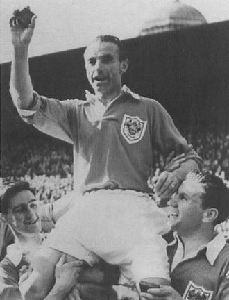 Stanley Matthews - Matthews lifting his 1953 FA Cup Final winner's medal to the sky, so that his deceased father could see it