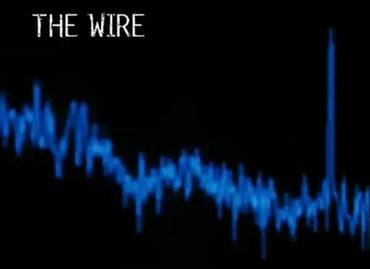 """The words """"The Wire"""" in white lettering on a black background. Below it a waveform spectrum in blue."""