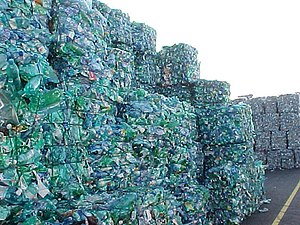 Bottle recycling - Bales of crushed PET bottles.