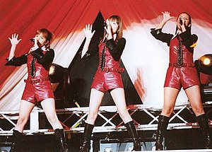 Coconuts Musume - Coconuts Musume in concert, 2002.   From left to right, Mika Todd, Ayaka Kimura, Lehua Sandbo.