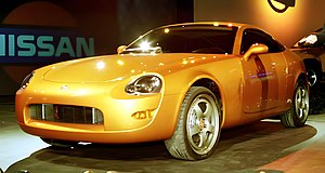 "Nissan 350Z - The 240Z Concept displayed in the same ""Lemans Sunset"" color seen on the 350Z"
