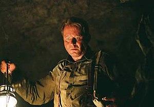 Lankester Merrin - Stellan Skarsgård as Lankester Merrin in Exorcist: The Beginning.