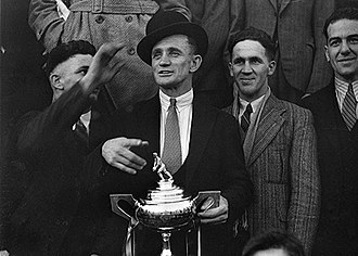 Frank McMillan - McMillan, as 1934's premiership-winning captain, with the Labor Daily Cup