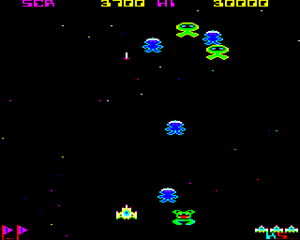 Galaforce - BBC Micro screenshot showing a multiplier formation. The green Patera aliens at the top of the screen are spawning the blue Quazars and the green Ejnar. The player is controlling the yellow spaceship.