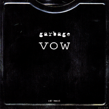 "A black metal-like box, with the title ""Garbage - Vow"" atop it."
