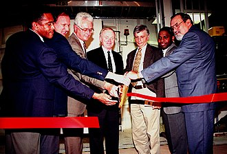 Jay Greene - As technical manager for the International Space Station, Jay Greene (third from right) takes part in a ribbon-cutting ceremony for a refurbished altitude chamber at Kennedy Space Center. It was to be used to perform leak tests on ISS modules.