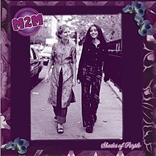Two teenage girls walking down a street together; the image uses a purple filter. 'M2M' appears in the upper left corner and 'Shades of Purple' appears in the bottom right. The cover has a purple, floral border.