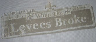 When the Levees Broke - The logo for the documentary, depicting a damaged New Orleans street sign.