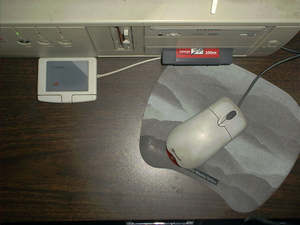 Cirque Corporation - A Cirque Easy Cat Desktop touchpad compared with a mouse and mousepad.