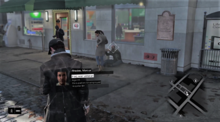 The player character walking through an urban environment, using his smartphone to scan the area. The heads-up display elements are visible onscreen.