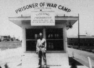 "Clinton, Mississippi - Camp Clinton entrance in 1943.  The sign reads ""Prisoner of War Camp Clinton, Miss."""