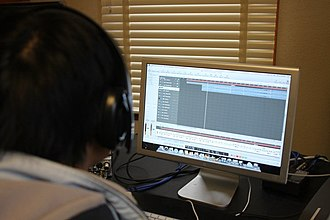 Stanford Mendicants - 2011 Musical Director De Wei Koh editing a track for Sh-Boom
