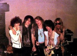 Guns N' Roses - The original lineup of Guns N' Roses in March 1985. From left to right: Rob Gardner, Izzy Stradlin, Axl Rose, Tracii Guns and Ole Beich.