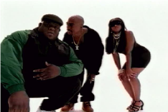 "All Eyez on Me - Shot from the ""Hit 'Em Up"" music video, with stand-in Biggie (left), Shakur (center), and Lil' Kim (right)"