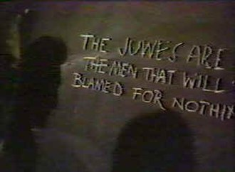 Murder by Decree - A still from Murder by Decree showing the Goulston Street graffito containing the word Juwes, which is portrayed erroneously as a Masonic term.