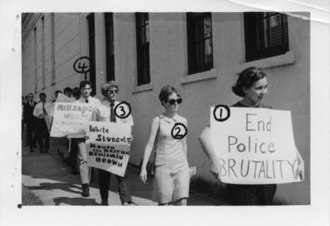 Mississippi State Sovereignty Commission - Millsaps College students protesting the death of Jackson State University student and civil rights worker Benjamin Brown, who was killed by police at a protest. Photo shot by the Commission with numbers used to identify individual students.