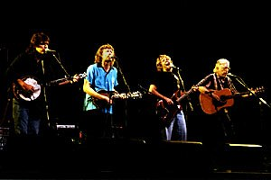 New Grass Revival - New Grass Revival reunion at beneficial concert for Courtney Johnson in 1996. From left: Béla Fleck, Sam Bush, John Cowan, Curtis Burch.