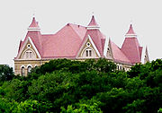 Old Main sits atop Chautauqua Hill and overlooks the campus. The Gothic-style building was added to the National Register of Historic Places in 1983.