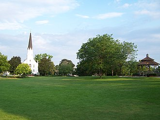 Itasca, Illinois - The Itasca Baptist Church across the street from Usher Park with the gazebo is an Itasca landmark.