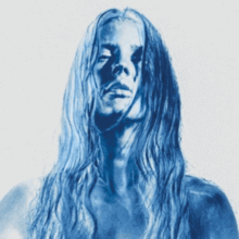 Image of a female with wet hair and negative blue hue effect.