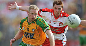 Gerard O'Kane - O'Kane (right) in action against Donegal's Brian Roper during the 2008 Ulster Championship