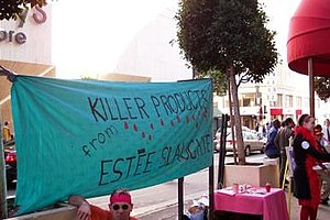 """QUIT activists outside Macy's San Francisco store on Valentine's Day, 2004. Banner says, """"Killer Products from Estée Slaughter."""""""