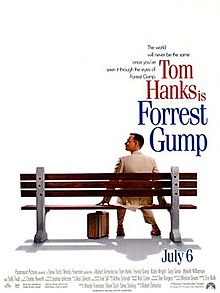 Film poster with an all-white background and a park bench (facing away from the viewer) near the bottom. A man wearing a white suit is sitting on the right side of the bench and is looking to his left while resting his hands on both sides of him on the bench. A suitcase is sitting on the ground, and the man is wearing tennis shoes. At the top left of the image is the film's tagline and title and at the bottom is the release date and production credits.