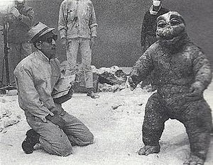 """Son of Godzilla - Sadamasa Arikawa gives instructions to Marchan the Dwarf (Minilla). """"Marchan the Dwarf"""" was partially hired to play the character partially for his ability to perform athletic rolls and flips inside the thick rubber suit."""