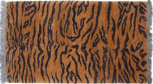 Tibetan rug - A Tibetan tiger rug (modern) with and abstract pelt design. Rugs like this were used as meditation seats when tiger skins were unavailable