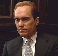 Robert Duvall portraying Tom Hagen