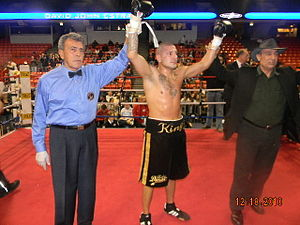 David Estrada (boxer) - Referee Gene Rodriguez, David Estrada and manager Wasfi Tolaymat in the ring at UIC Pavilion in Chicago after knocking out challenger Franklin Gonzalez in the fifth round of a scheduled ten rounder on Saturday night, December 17, 2010