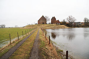 Ezinge - Church of Ezinge on the terp with left excavated terp as pastures and right the natural ice rink, Winter, 2012