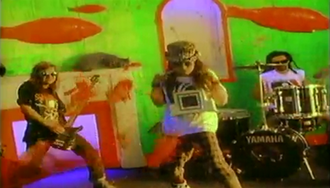 Falling to Pieces - A screenshot from the 1990 music video.