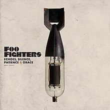 A torpedo with its bottom half replaced by an amplifier tube To the left is the text Foo Fighters and Echoes Silence Patience  Grace