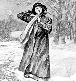 A young woman wearing a hat, scarf and long coat stands in a wintry scene, with snow on the ground and bare trees behind her.